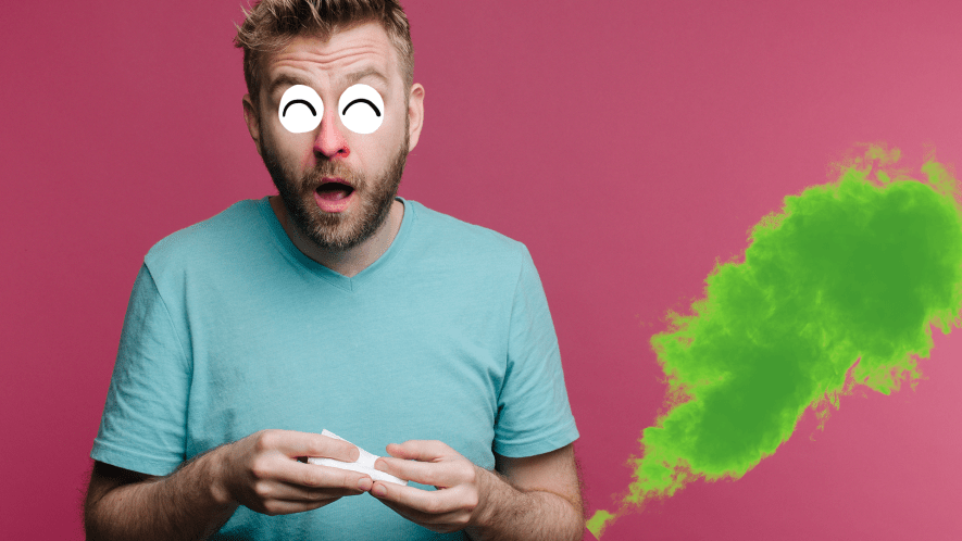 Sneezing man with fart cloud on pink background