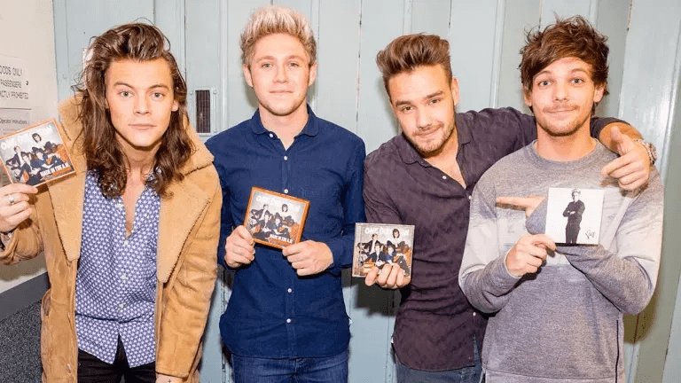 One Direction displaying a new CD release