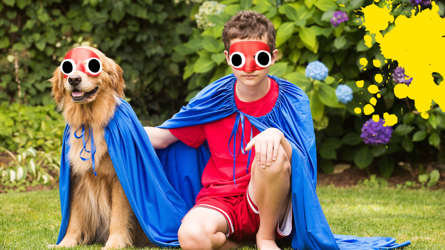 A boy and dog in capes, dressed as a crime fighting duo