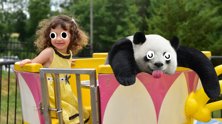 Girl on ride with derpy panda
