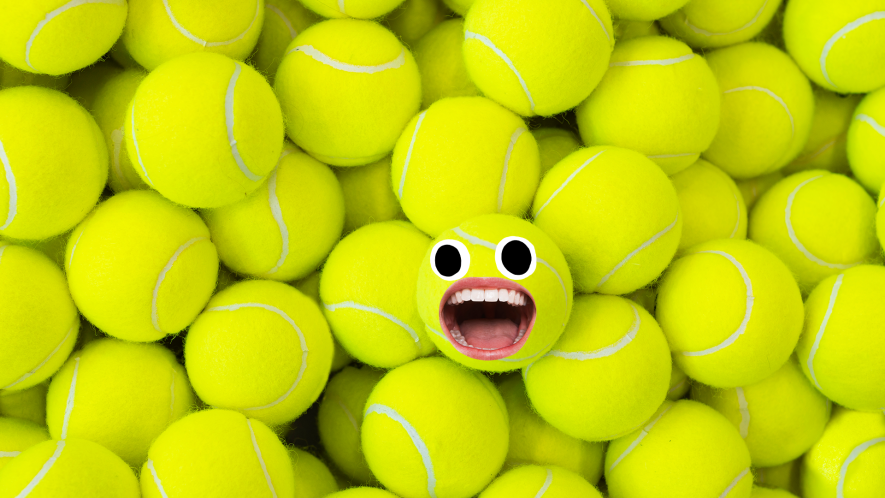 Pile of tennis balls with ball with face