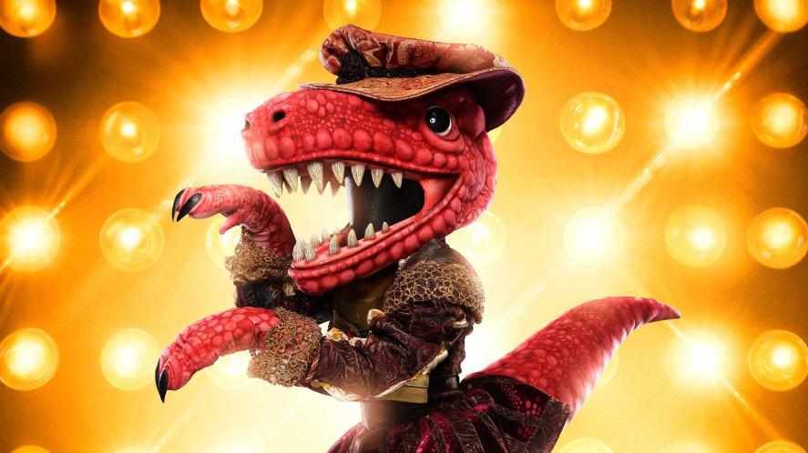 JoJo Siwa dressed as a dinosaur  in The Masked Singer