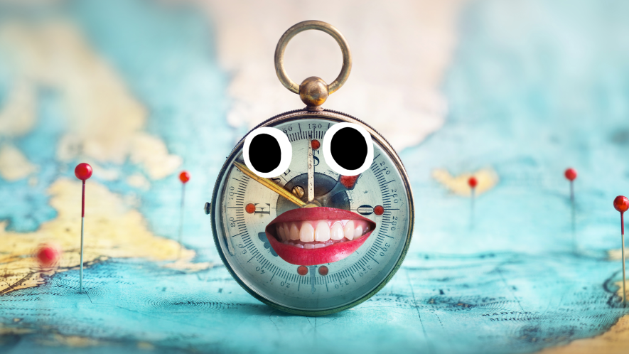 Map and compass with silly face