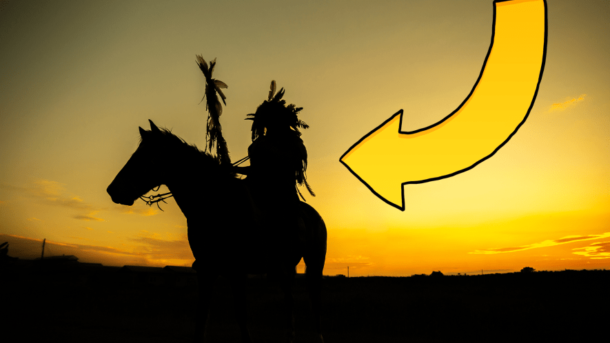 Person on horse in sunset with arrow