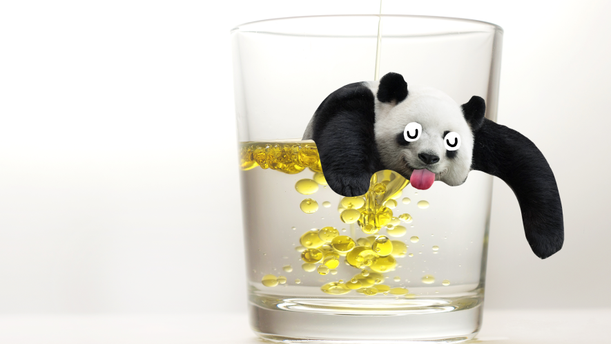 Glass of oil and water with derpy panda on white background