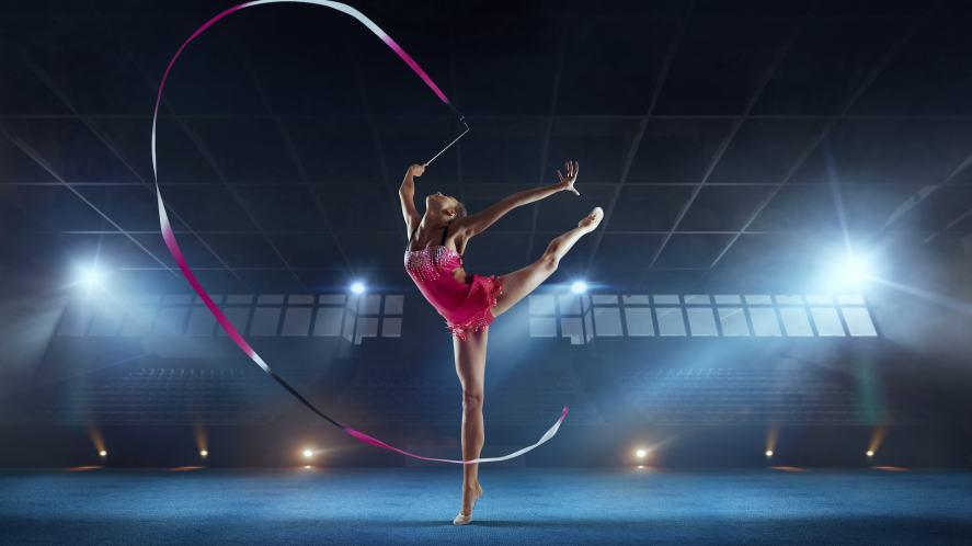 Rhythmic gymnast in a professional arena