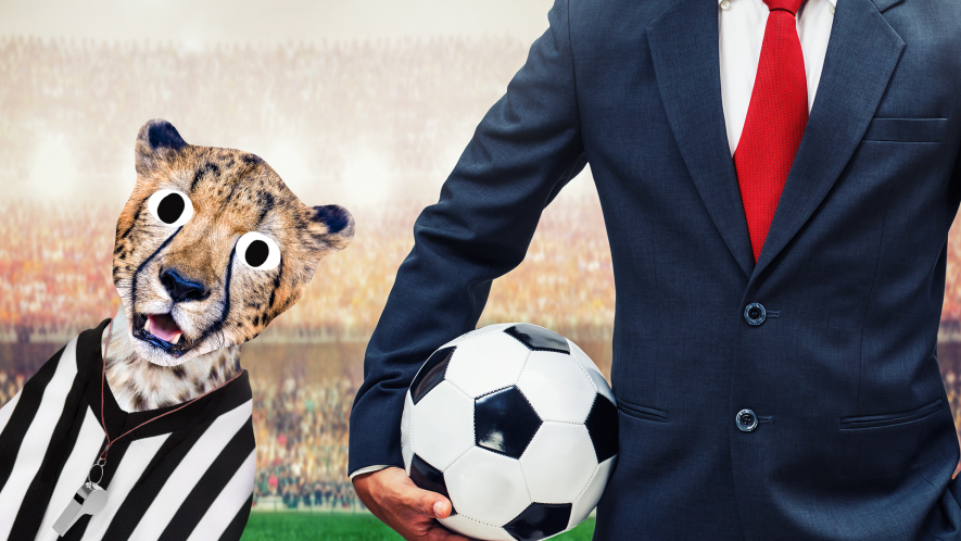 Man in suit with football and referee cheetah