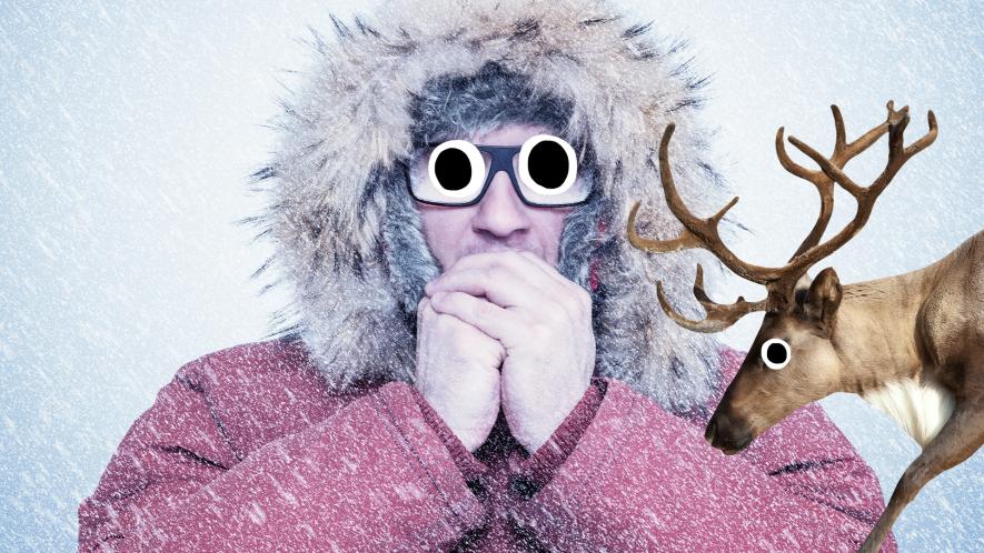 Man looking cold in coat with derpy reindeer