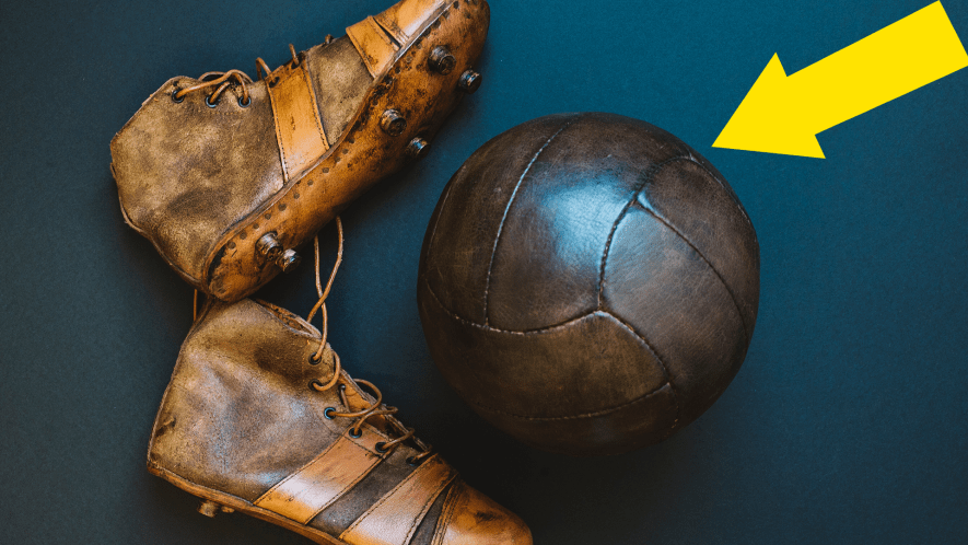 Old fashioned football and football boots