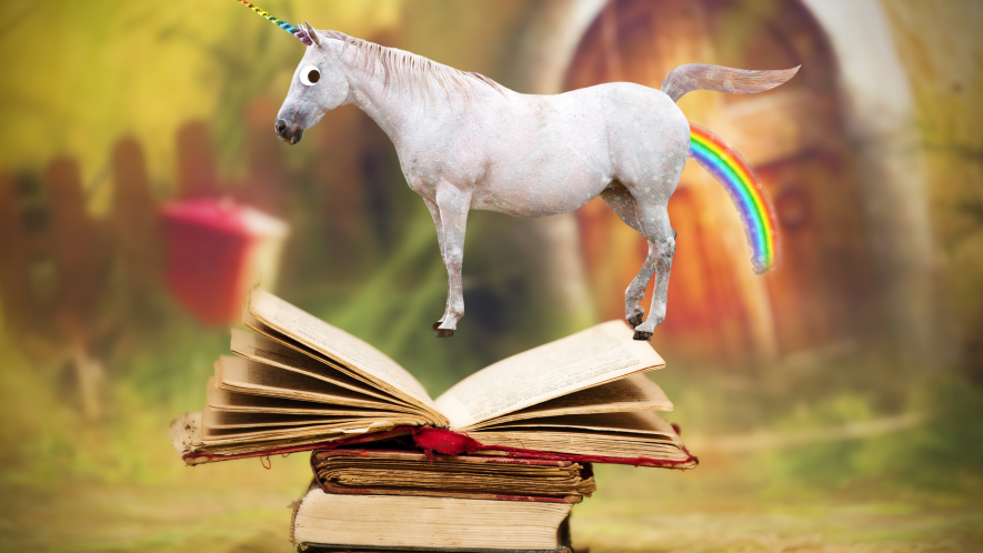 Unicorn farting rainbow on top of old book