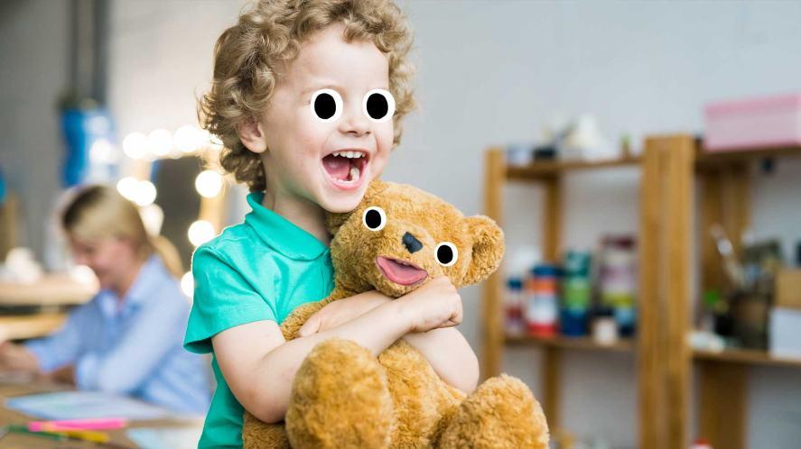 A boy holding a teddy bear