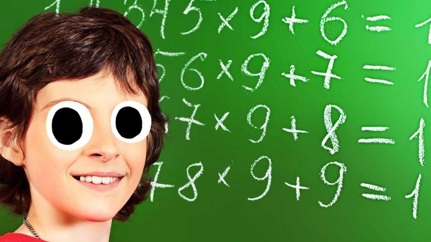 Maths questions on a chalk board