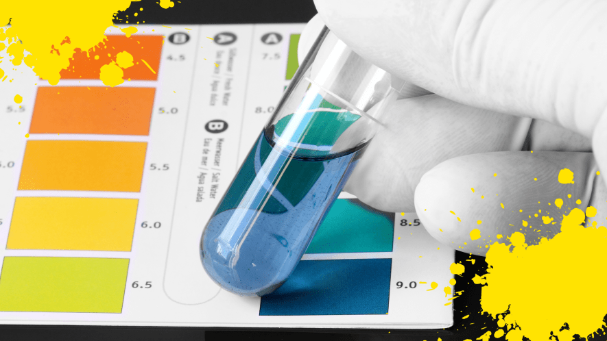 Hand holding test tube over litmus paper and yellow splats