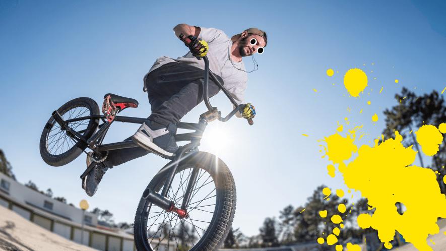Man on BMX with yellow splat