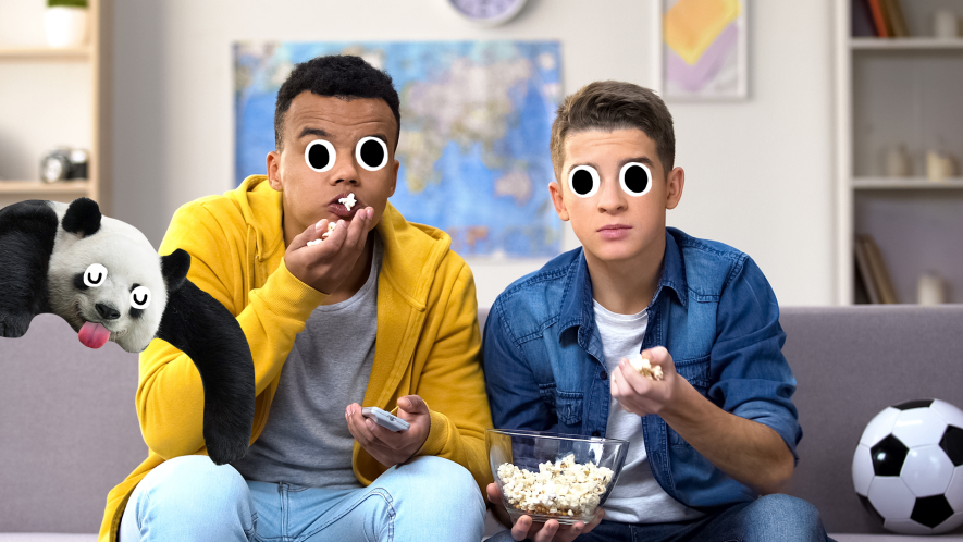 Two boys on sofa watching tv with popcorn, football and derpy panda