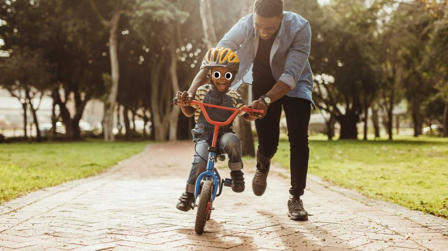 A father and son having fun on a bike