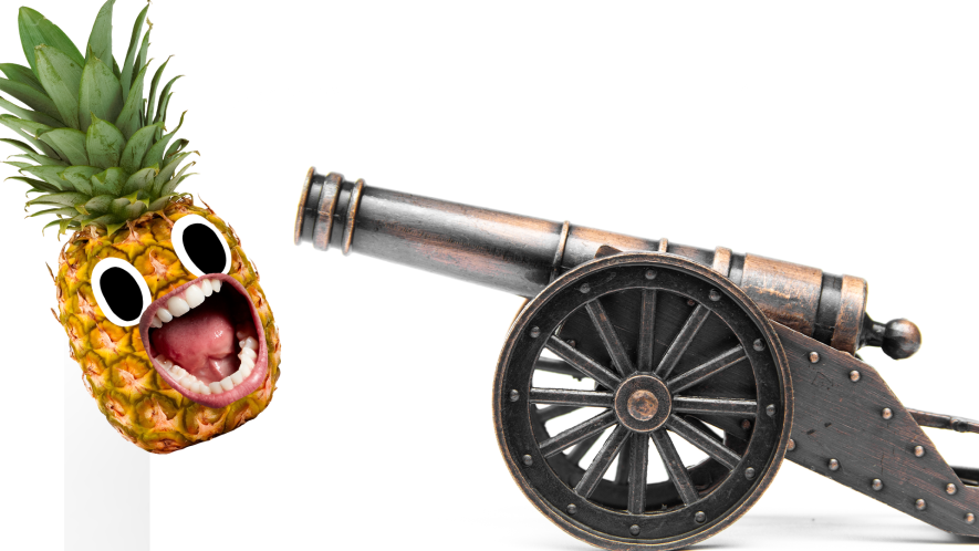 Cannon and screaming pineapple on white background
