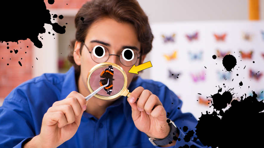 Man looking at butterfly through magnifying glass with arrow and black splatters
