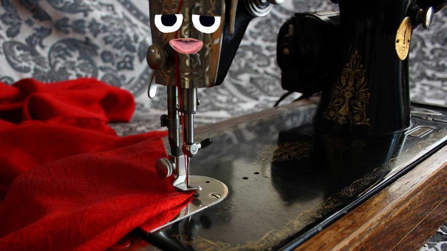 A sewing machine and a cape