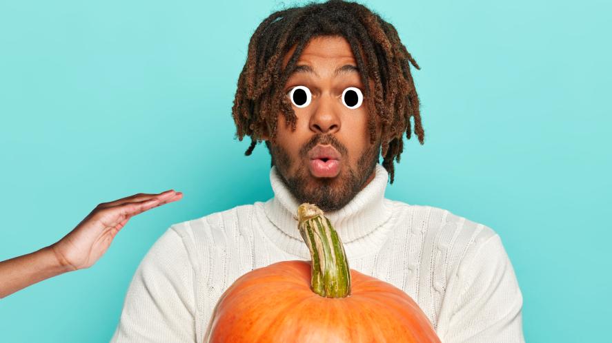 A man holding a pumpkin