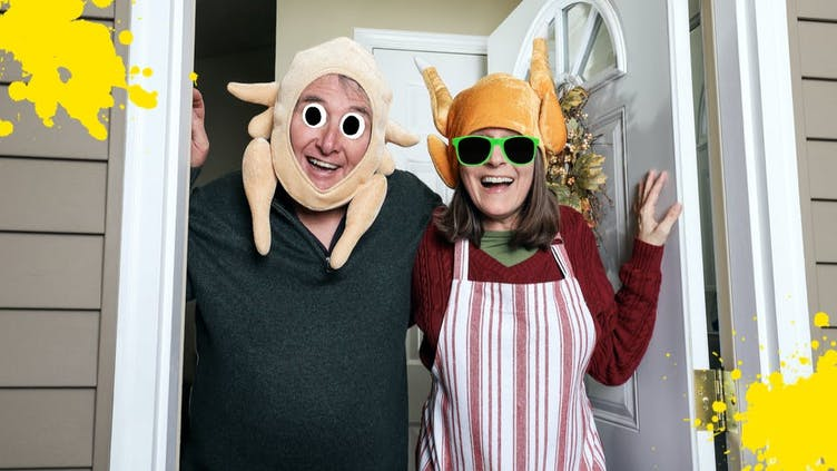 A couple wearing Thanskgiving turkey costumes
