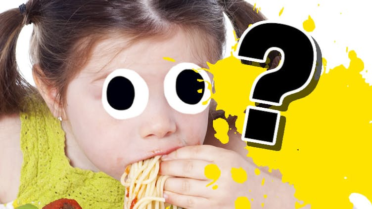A child eating noodles or spaghetti