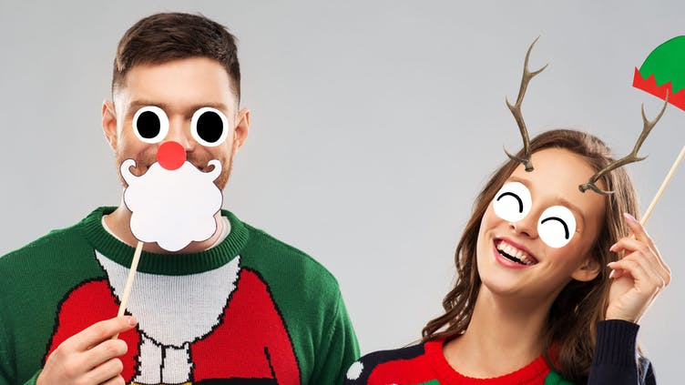 A man and woman with Christmas accessories on