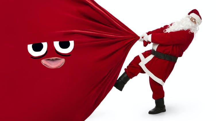 Santa dragging a bag of presents