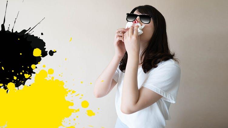 A person having a nosebleed