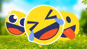 Emojis laughing in a grassy field