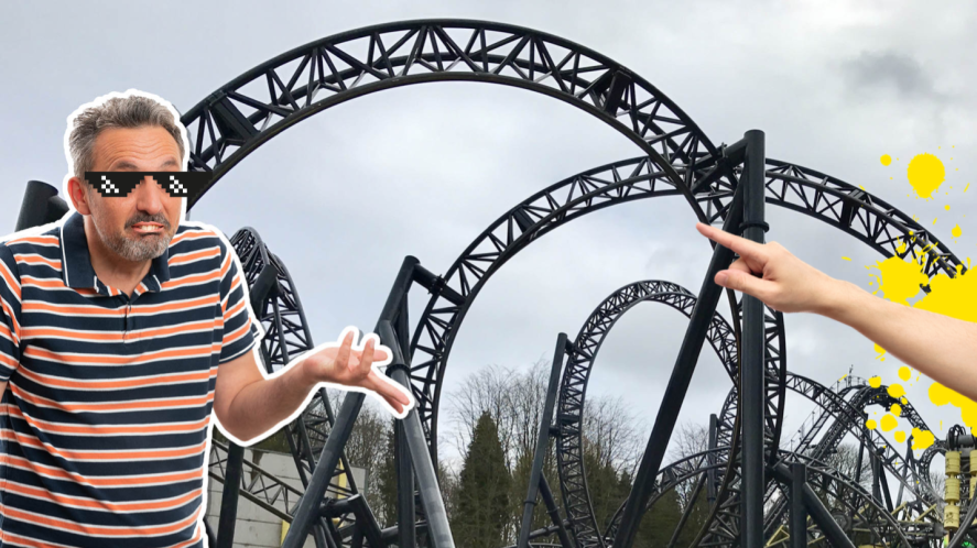 Man shrugging next to a rollercoaster