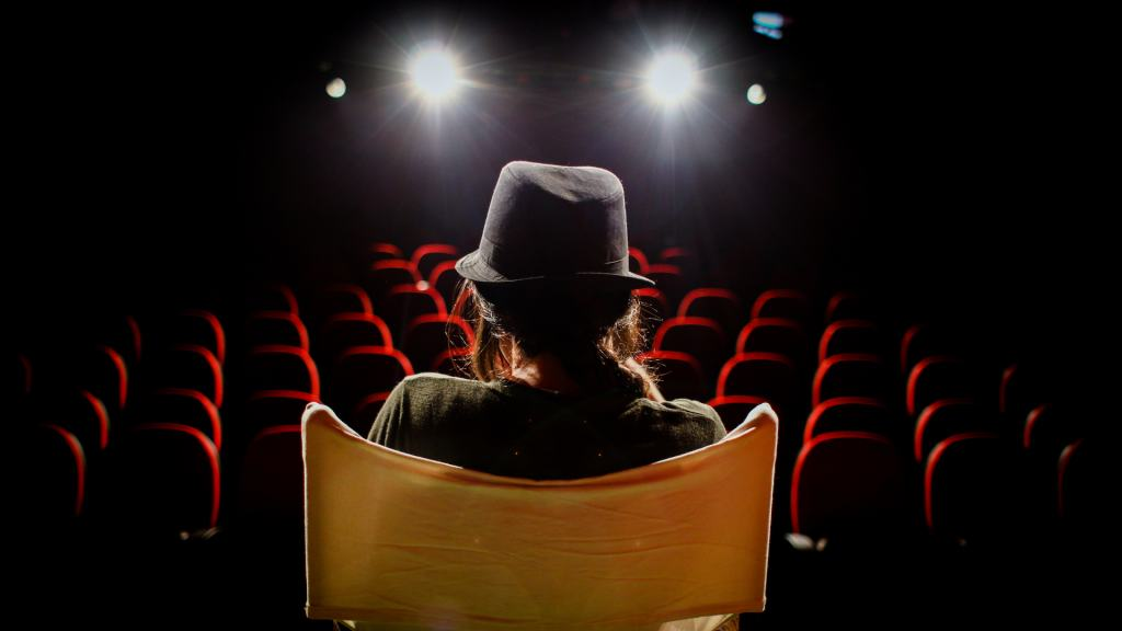 woman on director's chair on stage