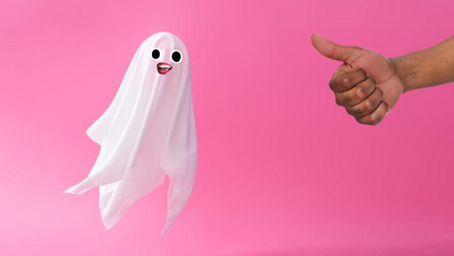 A ghost floating against a pink background