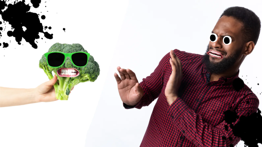 A man flinching at the site of broccoli
