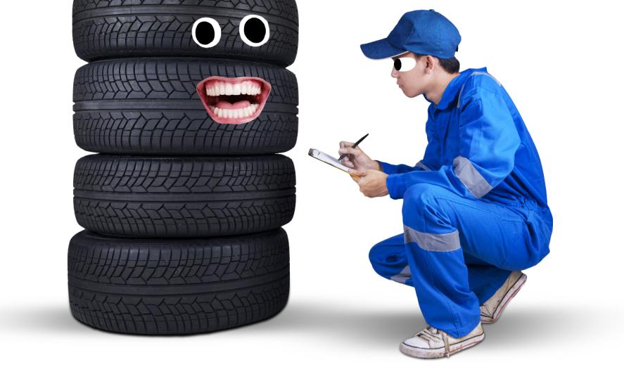 A mechanic examining tyres