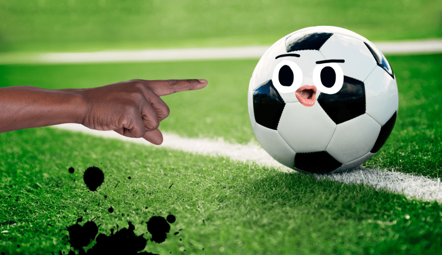 A hand pointing at a football