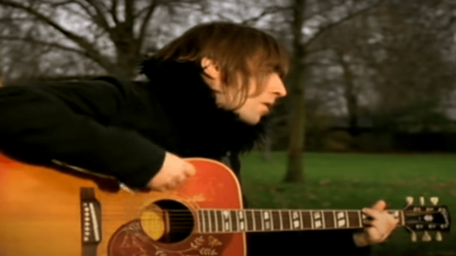 Liam Gallagher playing the acoustic guitar