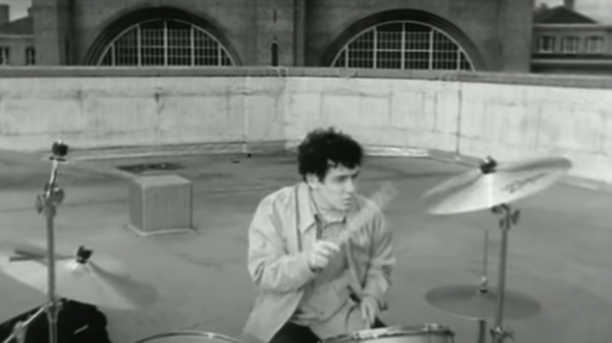Oasis drummer in a music video