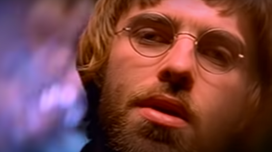 Liam Gallagher in a beard and round glasses