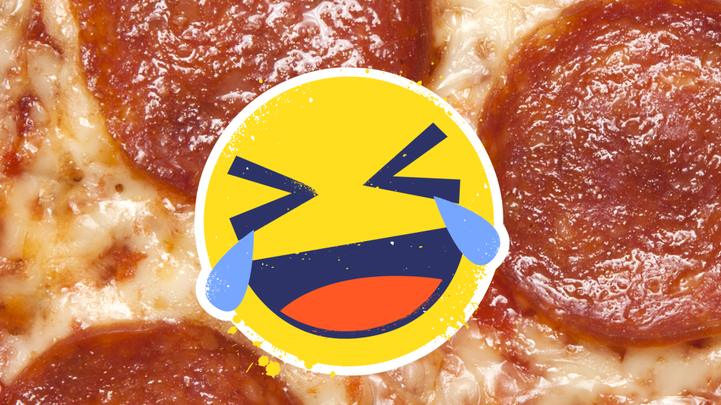 Crying laughing emoji in front of pizza