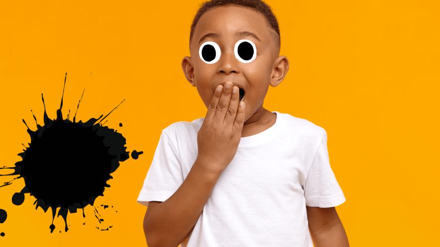 Little boy on orange background