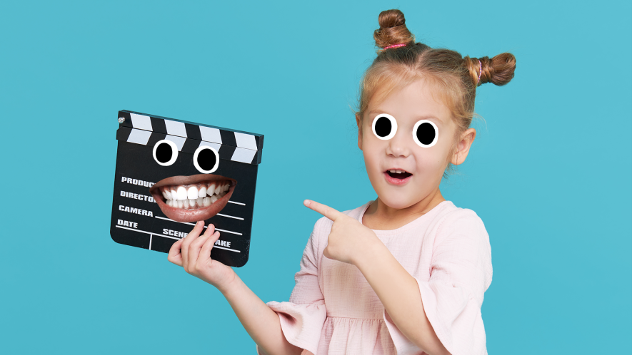 Little girl with clapper board