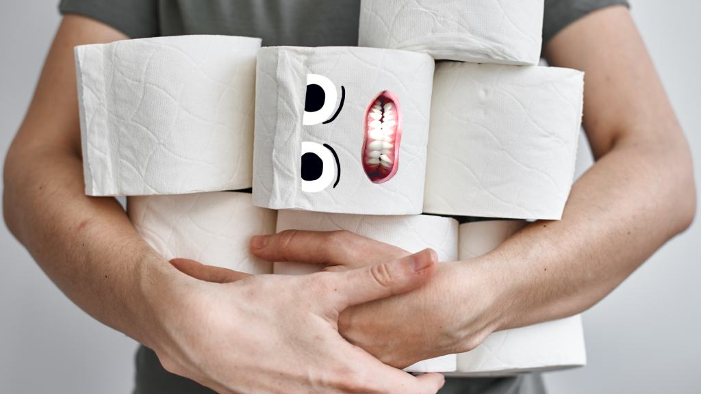 A man holding lots of toilet rolls