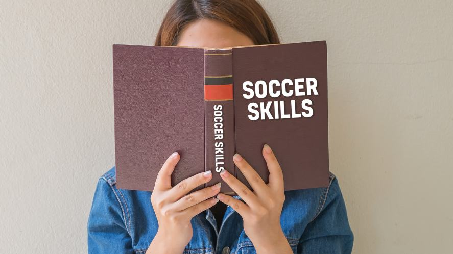 A person reading a Soccer Skills book