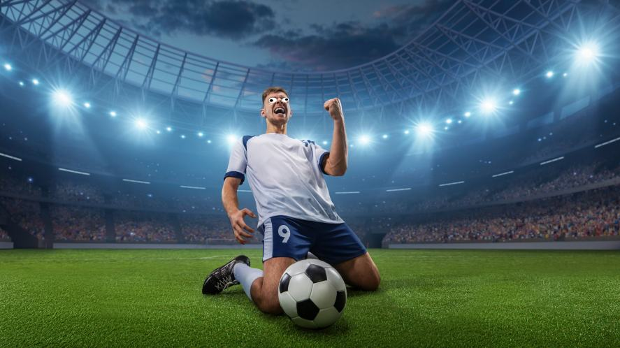 A footballer celebrating a goal