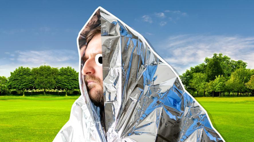 A runner keeping warm in a sheet of foil