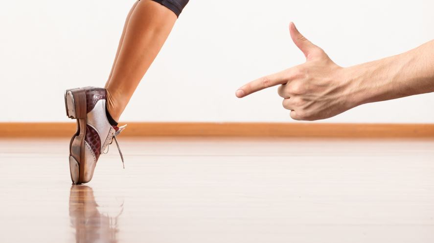 Someone pointing at someone's dance shoes