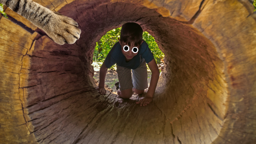 A forest school student in the middle of a big log