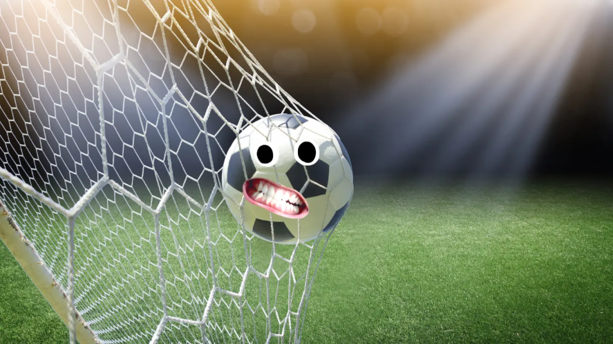 A football in the back of a goal