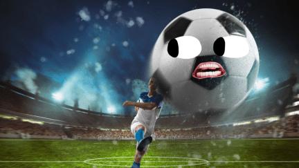 A footballer kicking a ball